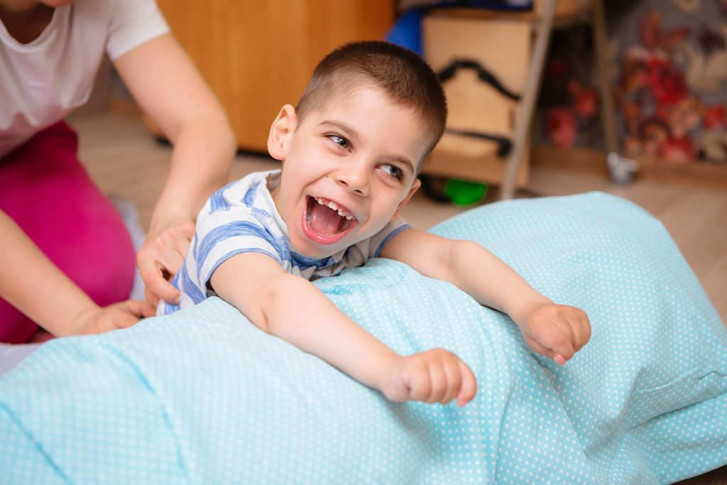 Child with CP receives physical therapy