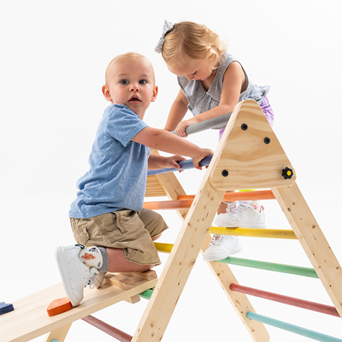 Toddlers playing together while wearing SMO orthotics