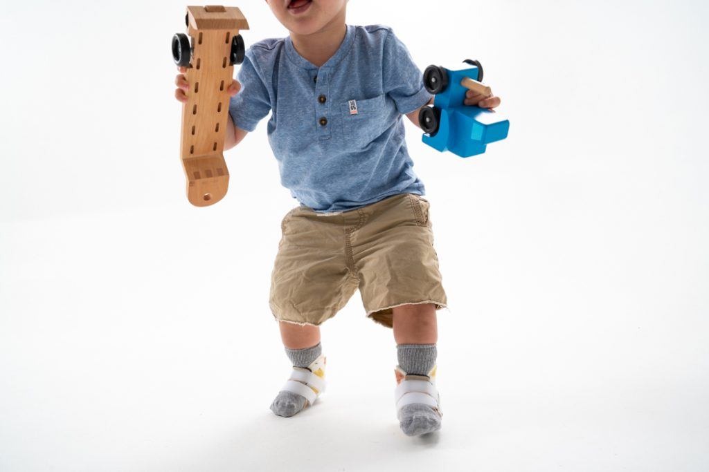 A toddler wearing SMOs